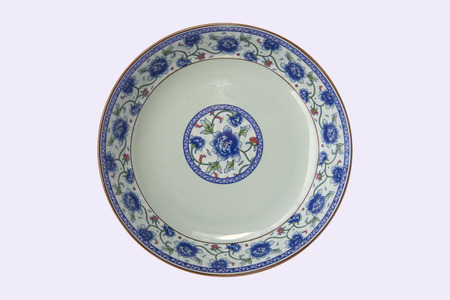 blue and white porcelain plate in white background Foto de archivo