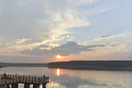 soul searching: Sunset on a Pier over lake
