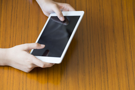 working woman: Woman working on tablet Stock Photo