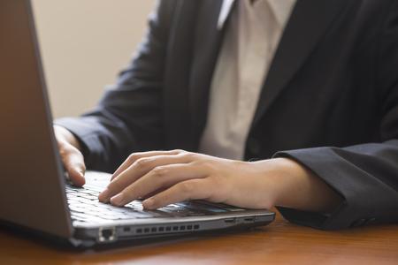 working woman: Woman working on laptop Stock Photo