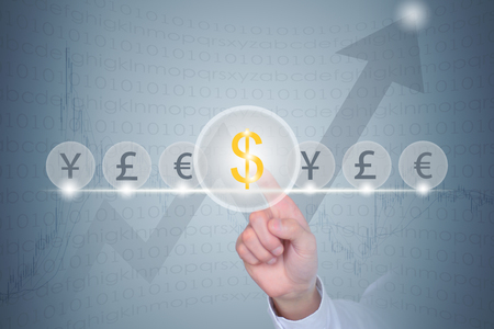 traders: Traders finger click on the choice of dollar sign global currency trading concept