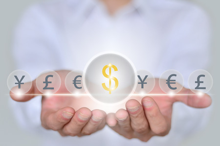 financial symbol: Businessman hands monetary (financial) symbol of global currency trading concept