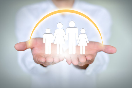 public welfare: People, family, charitable organizations and nursing concepts, close-up of two hands holding a family of four