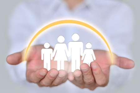 public welfare: People, family, charitable organizations and nursing concepts, close-up two hands holding a family of four