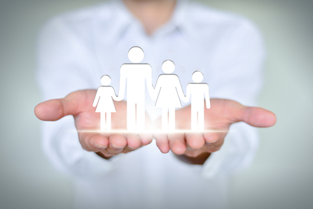 public welfare: The family and the relationship between concepts, holding hands in the close-up of a family of four