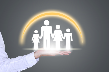 public welfare: People, family, charity and family health concept, holding the hands of the close-up of a family of four