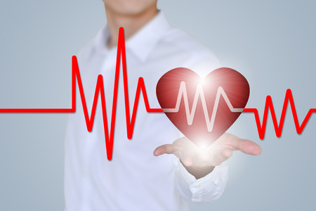 voluntary: Medical insurance, medical and health, the concept of charity, holding the 3D hearts and ECG features Stock Photo