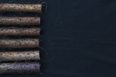 wild yam: Yam placed on the background of black linen Stock Photo