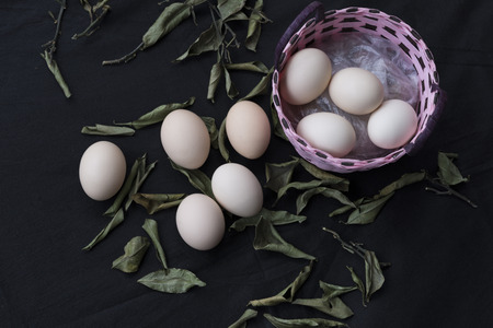 eggs in a basket on black background Stock Photo