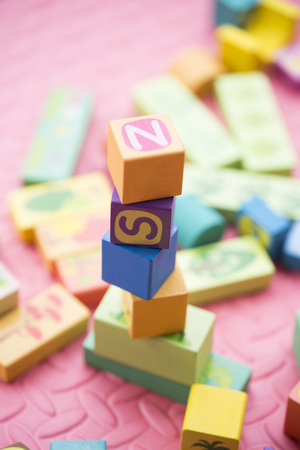 Stacked building blocks Stock Photo
