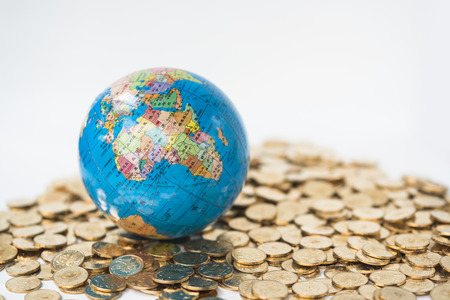 Earth model and gold coins