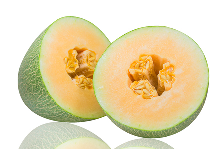 A Hami melon cut in half is isolated on a white background.