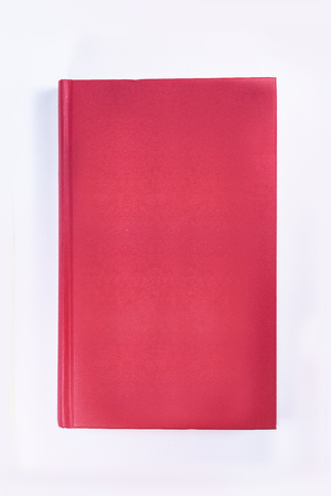 A dark red book on the white background