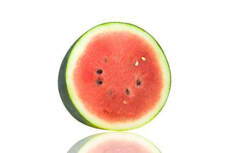 The cut half of the watermelon is isolated in the white background