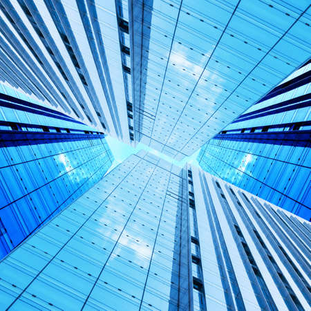Looking up at modern high-rise buildings.
