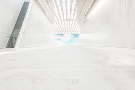 The interior space background of the corridor extending forward and cleanly illuminated.
