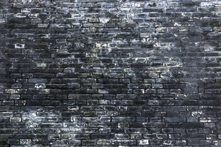 Mottled shabby blue brick wall texture background.