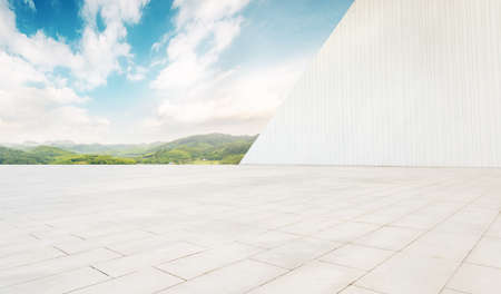 Clean and bright, geometrically shaped architectural space and mountains and rivers under the blue sky.