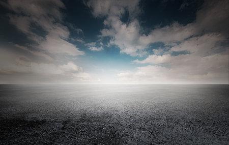 Dark concrete runway ground and dim horizon.