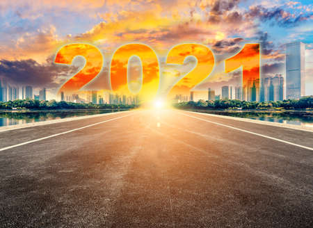 Straight ahead to the modern city with the New Year 2021 concept. The 2021 number written in modern cities.