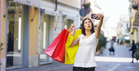 Shopping, and is very happy with their purchases in the period balances. Concept: fashion, shopping, happiness and fashion bloggers.