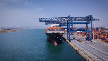 Beautiful view from the height (drone), view of a large cargo ship with blue sky and blue sky.