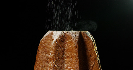 close up of a Pandoro, a typical Italian pastry eaten during the Christmas holidays and the New Year.