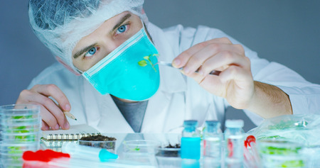 DNA and does research in biochemistry. Concept: analysis, DNA, bio, microbiology, augmented reality
