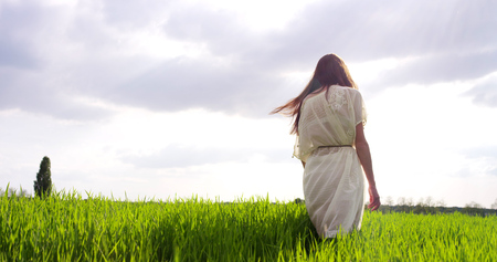 beautiful woman surrounded by the colorful nature turns on itself and breathes. You breathe is the best. clean air is a symptom of being and feeling good, enjoying life.