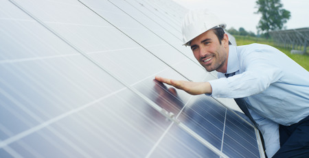 Photovoltaic solar panels. Concept: renewable energy, technology, electricity, service, green power.