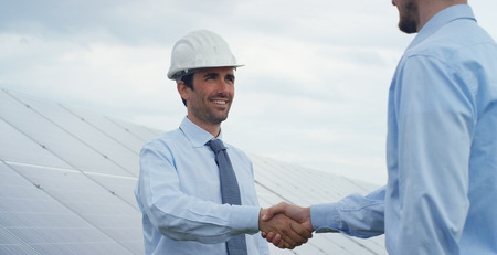 Two technical expert partners in solar photovoltaic panels, remote control performs routine operations to monitor the system using clean, renewable energy. The concept of remote support technology. Stockfoto - 113338500