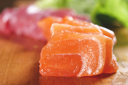 Macro shot of sushi, sashimi, uramaki and nighiri. typical Japanese dish consisting of rice, salmon or tuna, shrimp and fish eggs soaked in soy. Concept: Japanese restaurant, sushi, oriental tradition. Reklamní fotografie