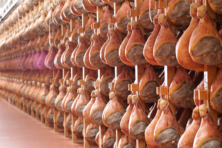 In a ham factory, there are hams to the end after having undergone the various processes according to the ancient Italian tradition. Concept of: tradition, italy, food