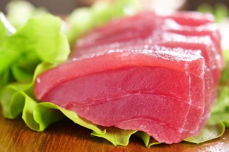 Macro shot of raw sushi, sashimi, uramaki and nighiri. typical Japanese dish consisting of rice, salmon or tuna, shrimp and fish eggs soaked in soy. Concept: Japanese restaurant.