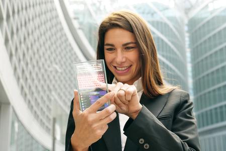 The woman in suit uses a holistic technology. Banco de Imagens