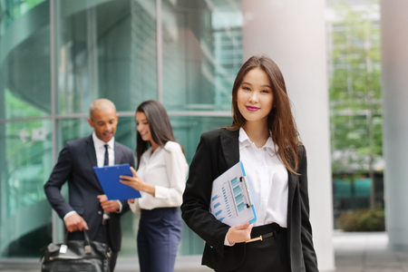 Group of multi-ethnic business people. Portrait of a asian business woman. Concept of: success and female career