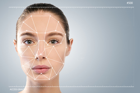 A woman with a facial mask and a facial mask. It can serve to ensure personal safety. Concept of: future, security, scanning.