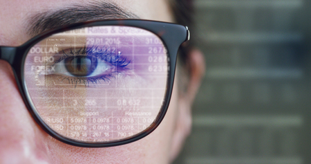 Close-up of a young woman looking at the camera and looking at the waveform lines concept of stock market, augmented reality, technology, stock exchange and finance