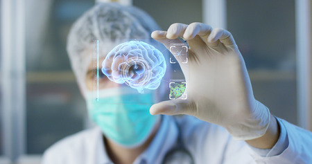 A physician, surgeon, examines a technological digital holographic plate. Concept: Futuristic medicine, the human body, and the future, brain Stockfoto