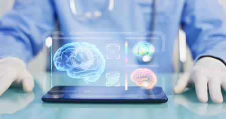 A physician, surgeon, examines a technological digital holographic plate. Concept: Futuristic medicine, the human body, and the future, brain