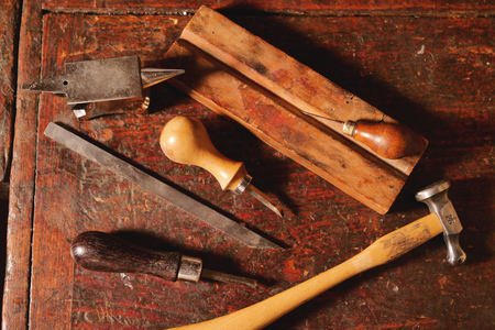 Composition of tools that a craftsman uses to build sweet flutes and crosspieces, made exclusively by hand and precious wood or ivory, in his own laboratory. Concept of: music, tradition 写真素材