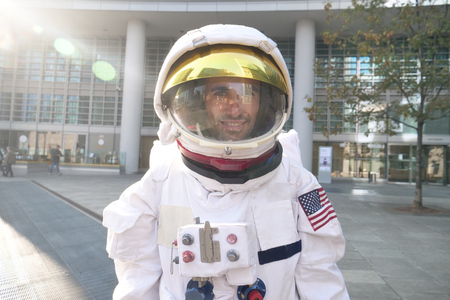 An astronaut just landed from space, on the new planet, walks in the middle of the world. Concept of: success road, dreams, astronaut, inspiration. 写真素材
