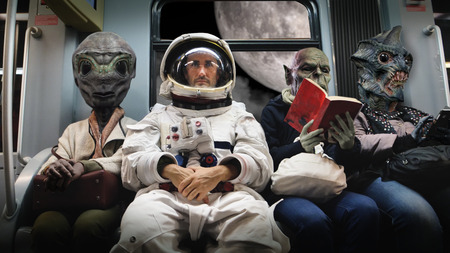 On a spaceship, an astronaut, sitting alongside extraterrestrial monsters, total relaxation reading a book. Concept of space transport, surrealism, future, new worlds.