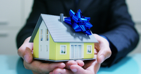 insurance of fire and theft .a house with floor plan and documents with ensured house keys.concept of home protection, family, insurance.rent house