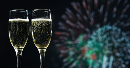 Champagne toast while in the background break out the fireworks. Concept: new year, love, holidays, party. Banco de Imagens