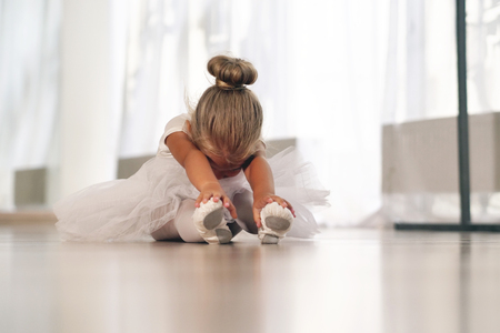 Train of a beautiful young girl, in a dance school wearing a white tutu. Concept of: ambition, education, elegance and love for the dance ...