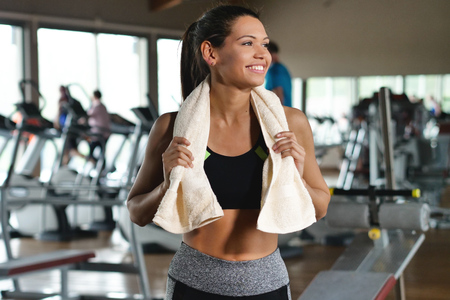 A woman in a gym with a gymnasium. Concept of: training, wellness, sport, gym, diet.