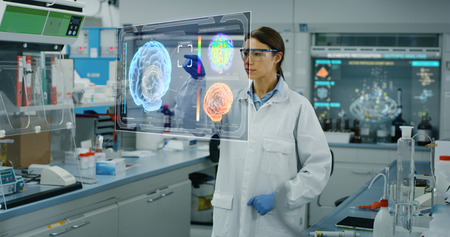 Portrait of a futurist researcher using the augmented reality screen. Concept of futuristic medicine and science