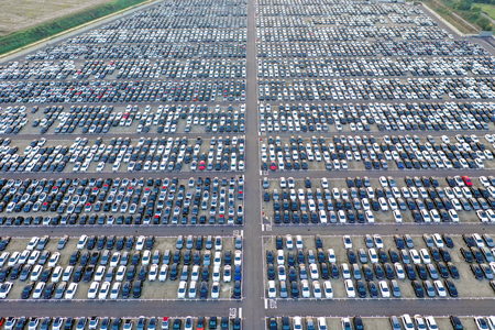 Aerial view of a large shopping center, full of cars. Concept: Traffic, transport, work. Stok Fotoğraf