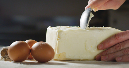 A chef prepares curls of butter, sweets, chef.